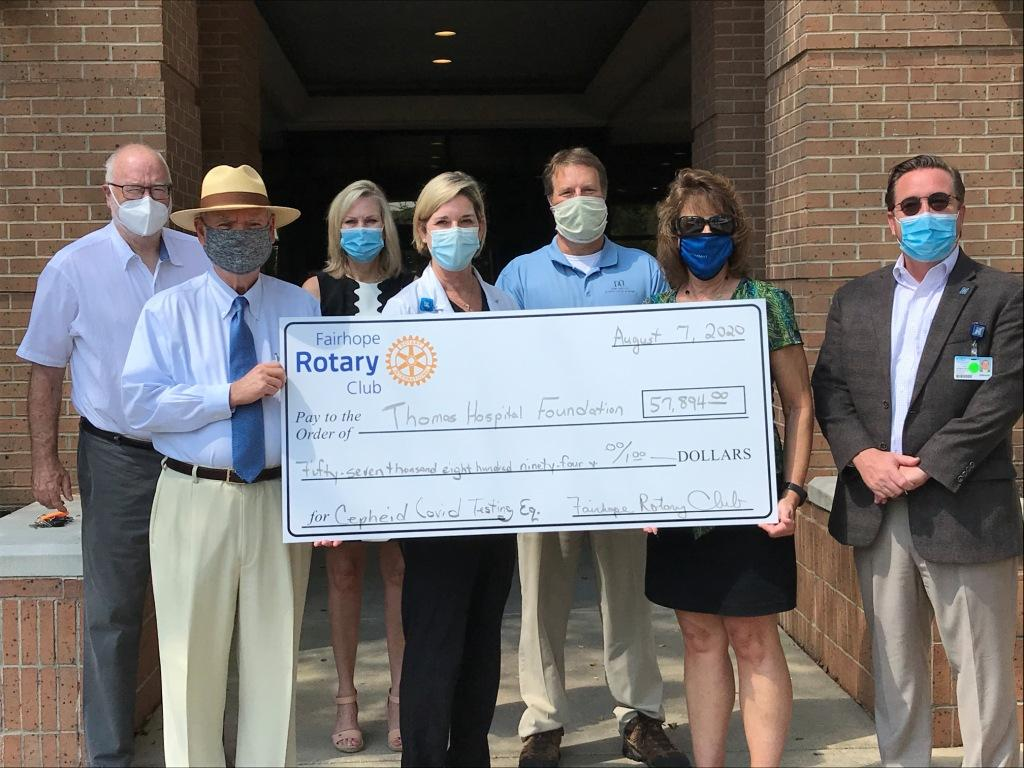 Photo of Rotarians presenting a check for $57,894 to Thomas Hospital Foundation